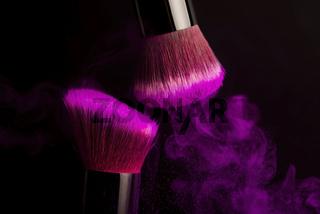 Cosmetics brush and colorful makeup powder