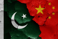 flags of Pakistan and China painted on cracked wall