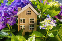 Wooden house in the countryside with flowers