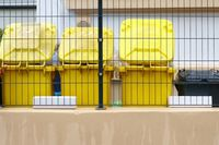 Yellow garbage cans