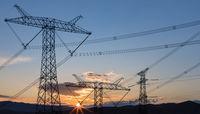 power transmission pylon in sunrise