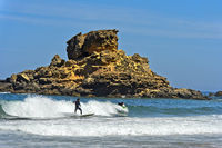 Surfer at the Costa Vicentina coast, Vila do Bispo, Portugal