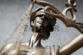 blindfolded lady justice or iustitia bronze statue