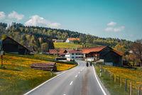 Two biker riding alone on mountainous road