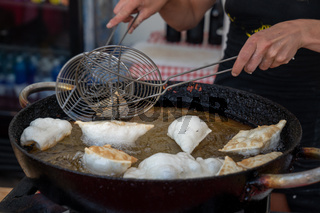 Dumpling deep frying in hot oil