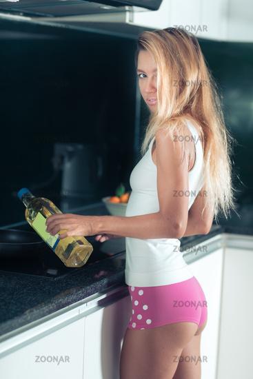 Beautiful woman at the kitchen