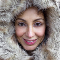 Young woman wearing furry hood
