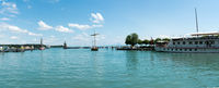 large passenger boat enters the historic harbor at Konstanz on Lake Constance