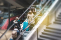 People on escalator in train station, travel concept motion blur