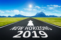 road to horizon with text new horizons 2019
