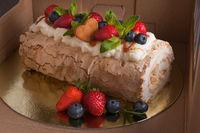 sponge cake with berries in box
