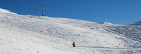 Skier downhill on snowy ski slope