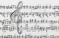 Treble clef on music sheet - musical background