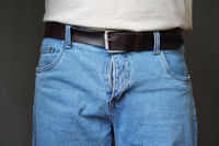 midsection of man dressed in jeans with open fly