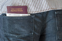Man with a french passport and boarding pass in the pocket