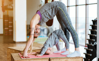 Mom and daughter together perform different exercises