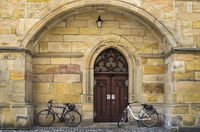 Bicycles parked at the church door. . .