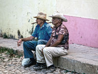 CUBA- FEBRUARY 04, 2013: two elderly Cubans with cigars