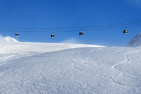 Gondola lift and off-piste ski slope in fog