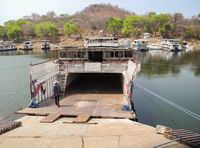 Off road vehicle loading on a ferry at Lake Kariba lake