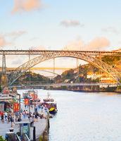 People walking Porto promenade bridge