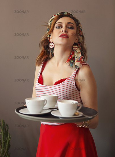 Beautiful young woman wearing bright clothes holding tray with coffee