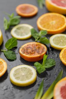 close up of grapefruit, orange, pomelo and lime