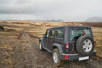 Car on Icelandic terrain