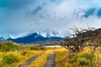View of Cuernos Del Paine mountain with fog and rain clouds at Lake Pehoe