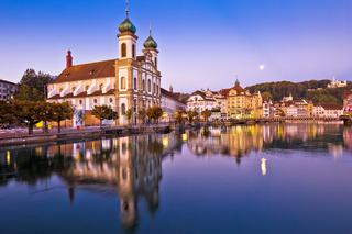 Luzern church and Reuss river waterfront dawn view