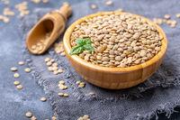 Bowl of brown lentils. Vegetarian food.
