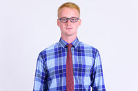 Portrait of young handsome blonde businessman with eyeglasses
