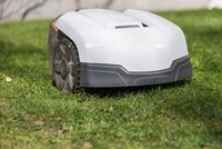 Mowing the lawn with a robotic lawnmower - close up automower