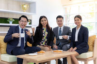 businesspersons celebrate in cafe