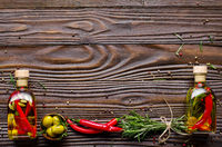 Flat lay Food background frame made of oils condiments and spices on kitchen table. Cooking concept with copy-space