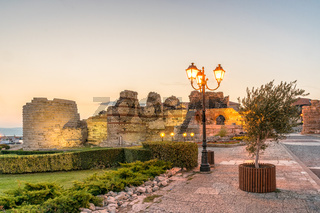 Ancient ruins at the entrance of the Nessebar ancient city at sunrise on the Bulgarian Black Sea Coast. Nesebar, Nesebr is a UNESCO World Heritage Site. Ruins at sunrise in Nessebar, Bulgaria