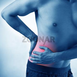 Man suffering from acute pain on abdomen