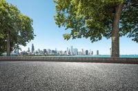 asphalt highway through garden with skyline