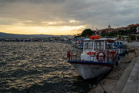 Bay of Sozopol in the early morning. Pleasure boat stands near the pier.