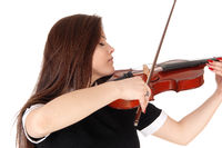 A woman playing the violin in a close up image