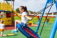 Various swings on the playground in the summer outdoors