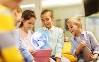 children with tablet pc and earth planet hologram