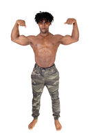 African man standing and flexing his muscles