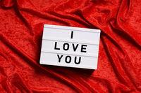 I love you lightbox on red velvet background