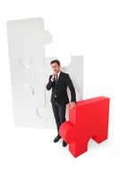 Business man with puzzle pieces