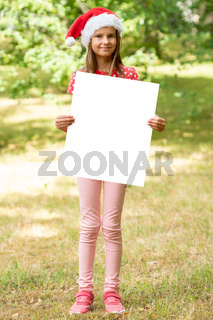 Girl with Christmas hat holds blank sign