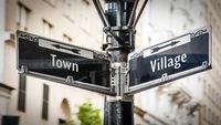 Street Sign to Village versus Town