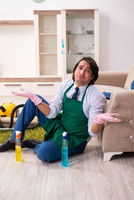 Young businessman cleaning the house