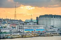 Kyiv skyline with embankment at sunset
