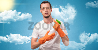 Sunny concept with housekeeper and orange gloves